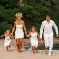 Happy family running together motion portrait of young towards camera on beach Stock Photos