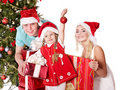 Happy family in santa hat holding gift box. Stock Photo