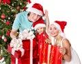 Happy family in santa hat holding gift box isolated Stock Photos