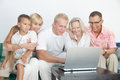 Happy family scandinavian to be together to operate with computer Royalty Free Stock Photos