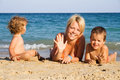Happy family by the sea Stock Images
