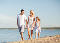 Happy family at the seaside summer holidays children and people concept Stock Photos