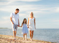 Happy family at the seaside summer holidays children and people concept Stock Images