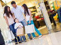 Happy family shopping bags mall Royalty Free Stock Photo