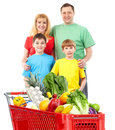 Happy family with a shopping cart isolated over white background Royalty Free Stock Images