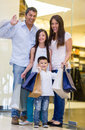Happy family shopping holding bags mall Royalty Free Stock Photography