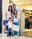 Happy family shopping thumbs up smiling Stock Photos