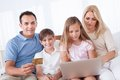 Happy Family Shopping Using Laptop Stock Photography