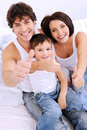 Happy family showing thumbs-up gesture Royalty Free Stock Photos