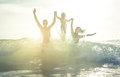 Happy family silhouette in the water Royalty Free Stock Photo