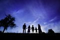 Happy family silhouettes of parents having fun with their children Royalty Free Stock Images