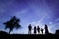 Happy family silhouettes of parents having fun with their children Stock Images