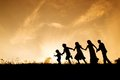 Happy family silhouettes of parents having fun with their children Stock Image