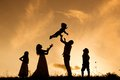 Happy family silhouettes of parents having fun with their children Royalty Free Stock Photography