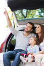 Happy family sitting in car the Stock Photos
