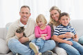 Happy family sitting with pet kitten together Royalty Free Stock Photo