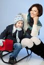 Happy Family Sitting On A Sled At Winter Time Royalty Free Stock Photos