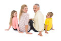 Happy family sitting and smiling on white background Stock Photos