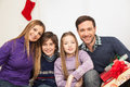Happy family sitting together in christmas celebrating Stock Photo