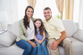 Happy family sitting together on sofa portrait of at home Stock Image
