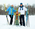 Happy family skiing Stock Photography