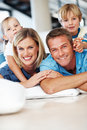 Happy family smiling at home Royalty Free Stock Images