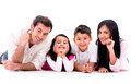 Happy family smiling isolated over a white background Royalty Free Stock Images
