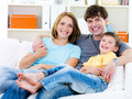 Happy family with son on the sofa Stock Photo
