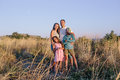 Happy family spending time together in field Royalty Free Stock Photo
