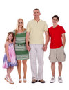 Happy family standing by holding their hands Royalty Free Stock Photography