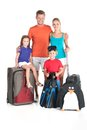 Happy family standing with luggage on white background man hugging women and holding baby Stock Photography