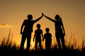 Happy family standing in the park at sunset time concept of friendly Royalty Free Stock Image