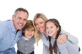 Happy family standing and smiling at camera on white background Stock Images