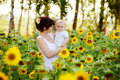 Happy family in summer field of beautiful sunflowers Royalty Free Stock Photo
