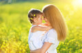 Happy family on summer. little girl child baby daughter hugging Royalty Free Stock Photo