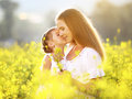 Happy family on summer. little girl child daughter hugging and k Royalty Free Stock Photo