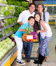 Happy family at the supermarket Stock Image