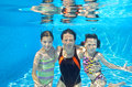Happy family swim underwater in pool and having fun mother and children on vacation Royalty Free Stock Image