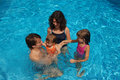 Happy family in swimming pool Royalty Free Stock Photos