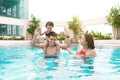 Happy family in swimming pool. Summer holidays and vacation concept Royalty Free Stock Photo