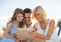 Happy family with tablet pc taking picture summer holidays children and people concept Stock Photography