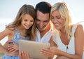 Happy family with tablet pc taking picture summer holidays children and people concept Stock Images