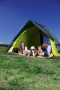 Happy family in tent Royalty Free Stock Photography