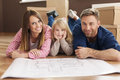 Happy family in their new home planning apartment Royalty Free Stock Photos