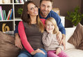 Happy family in their new home portrait of loving at Stock Photography