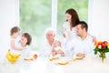 Happy family with three children enjoying breakfast Royalty Free Stock Photo