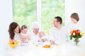 Happy family with three children visiting grandmother Royalty Free Stock Photo