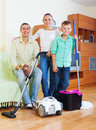 Happy family of three finished housework portrait in home Stock Photography