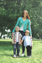 Happy family together! Mother and two children sons walking Royalty Free Stock Photo