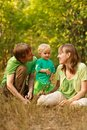 Happy family together in nature Stock Photo